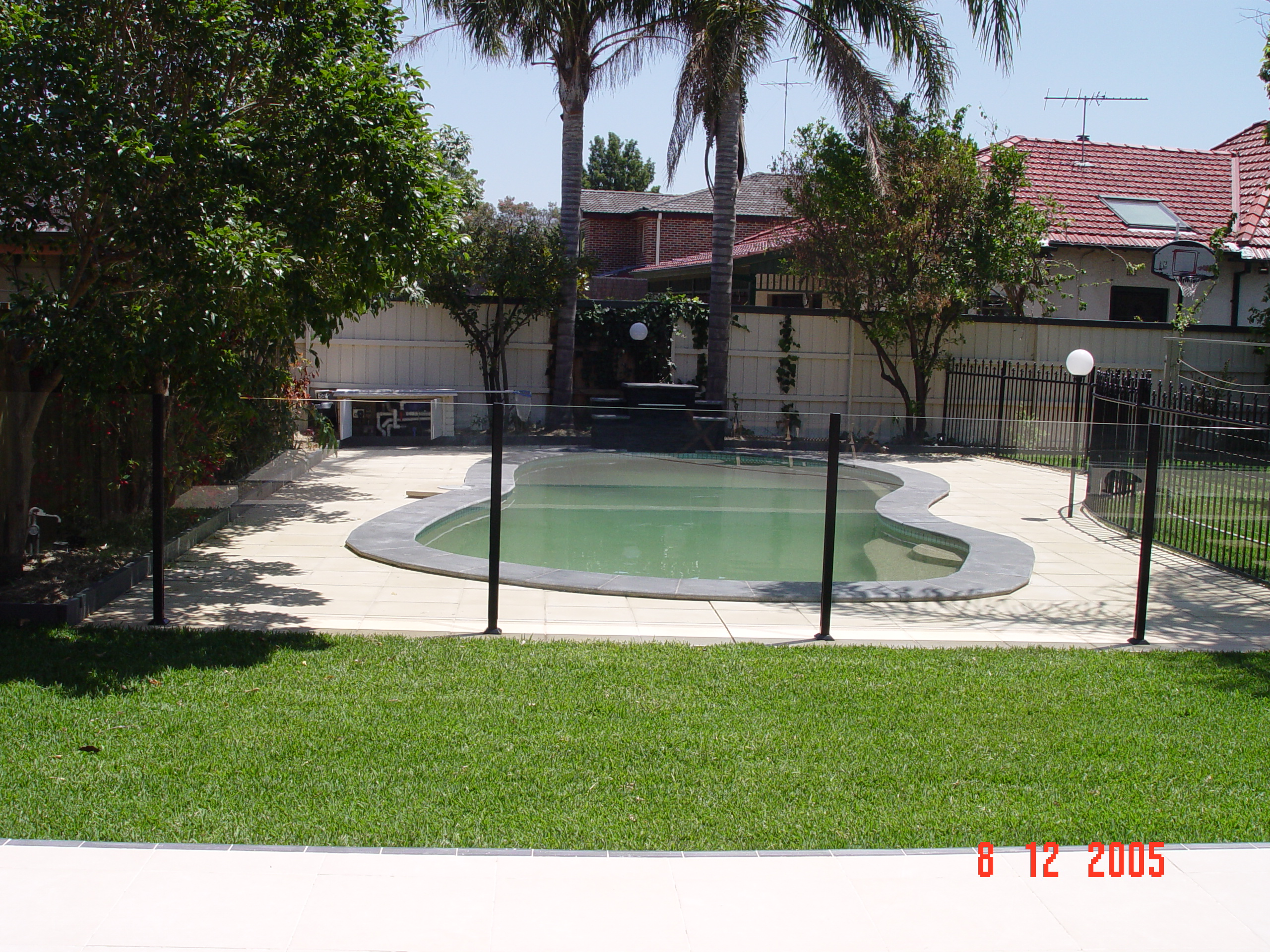 Semi Frameless Pool Fence with Black Posts